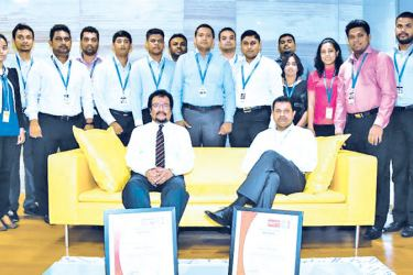 Laugfs Holdings Chairman W. K. H. Wegapitiya, Managing Director Thilak De Silva and the Group IT team with the ISO/IEC 27001:2013 certification.