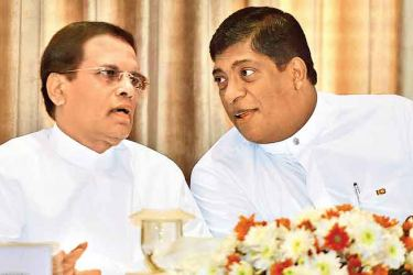 President Maithripala Sirisena in conversation with Finance Minister Ravi Karunanayake at the 16th Annual Meeting of the Inland Revenue Commissioners Association at the Kingsbury yesterday.  Picture by Malan Karunaratne