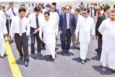 Transport and Civil Aviation Minister Nimal Siripala de Silva yesterday commissioned  the renovated runway of the Bandaranaike International Airport. Deputy Megapolis and Western Development Minister Lasantha Alagiyawanna was also present. Pictures by Samantha Weerasiri