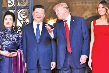 US First Lady Melania Trump (R) and President Donald Trump (2nd R) pose with Chinese President Xi Jinping (2nd L) and his wife Peng Liyuan (L) upon their arrival at Mar-a-Lago.