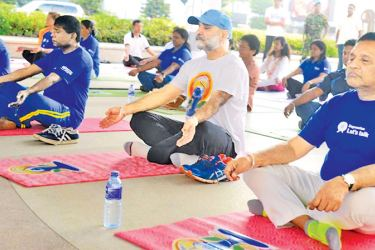 Health  Minister Dr. Rajitha Senaratne and others engaged in Yoga  workouts during the  World Health Day celebrations held in Colombo.