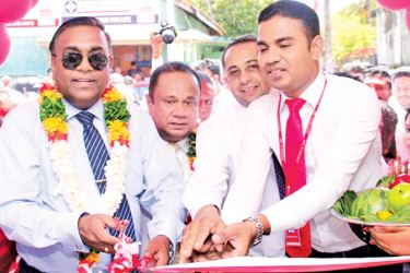LB Finance Deputy General Manager Marlon Perera and others opening the branch. Picture by Mohammed Imithiyaz.