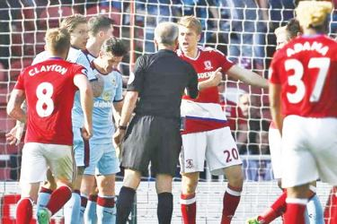 Middlesbrough's Patrick Bamford appeals to the referee Martin Atkinson after being fouled by Burnley's Michael Keane.