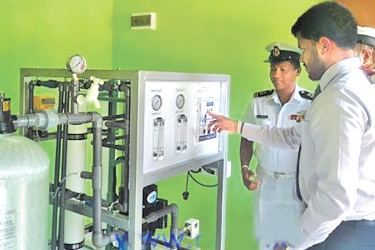 Navy personnel installing reverse osmosis plants