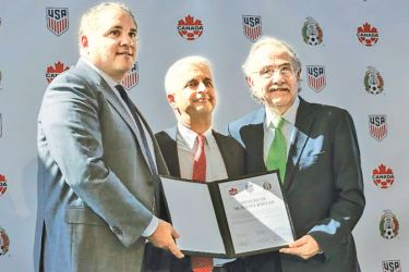 Sunil Gulati President of United States Soccer Federation (C) poses for a picture next to Victor Montagliani CONCACAF President (L) and Decio de Maria President of the Mexican Football Federation (R) after announcing the next soccer 2026 World Cup in North America during a press conference on April 10, 2017 at the One World Trade Center in New York. The United States, Mexico and Canada announced a joint bid to stage the 2026 World Cup on Monday