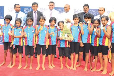 Grade 4 girls champion Sri Buddharaja MV team with their trophy along with guests and Nestle Lanka representatives.