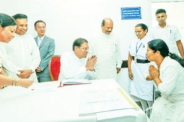 President Sirisena admitting the first patient to  the new ward complex