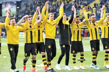 Borussia Dortmund players as they celebrate after the match against Eintracht Frankfurt in the Bundesliga at Signal Iduna Park, Dortmund on Saturday.