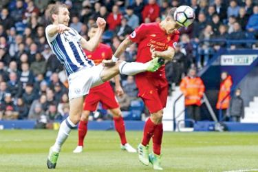 Liverpool's Roberto Firmino scores their first goal against West Bromwich Albion at the Hawthorns on Sunday.