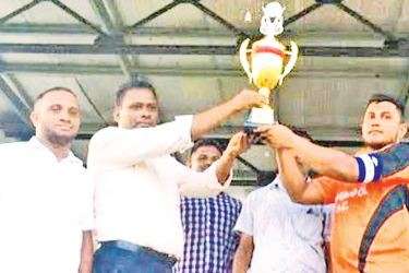 The Pottuvil Divisional Secretary A.M.M.Musarath the chief guest at the prize giving ceremony of the match and awarding the trophy. Picture by I. L. M. RIZAN, Addalaichenai Central Correspondent