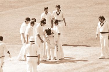 Members of the Australian team gather around Sunil Wettimuny after he was hit on the chest by Jeff Thomson.