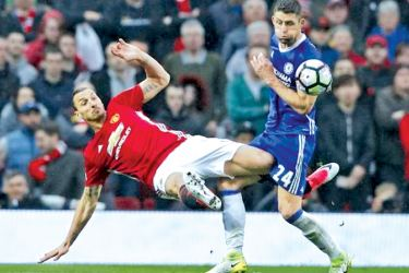 Manchester United's Zlatan Ibrahimovic in action with Chelsea's Gary Cahill in their Premier League match at Old Trafford on Sunday.