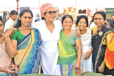 Dishani with the community leaders.  Pictures by Vipula  Amarasinghe