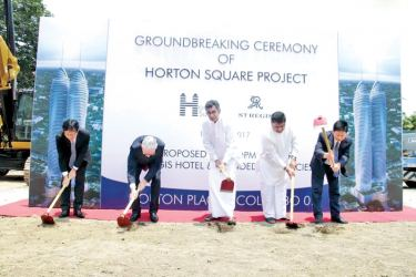 Minister Champika Ranawaka and investors of Horton Square Mixed Development protect at the ground breaking. Pictures by Saliya Rupasinghe