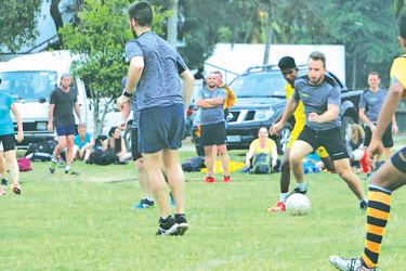 Action at the match between Unis Vers le Sport France and Matara City FA