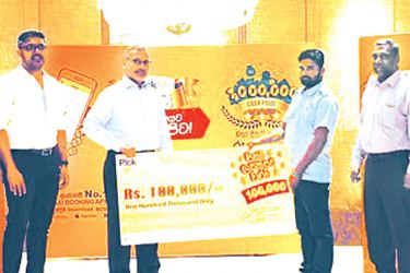 The fifth driver Tharanga Pushpakumara who drives a three wheeler, collected his cheque from  Ajit Gunewardene, Chairman of PickMe. Jiffry Zulfer, Chief Executive Officer of PickMe is in the picture.