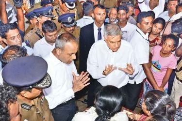 Prime Minister Ranil Wickremesinghe visited the Rahula Vidyalaya premises in Meethotamulla to look into the welfare of the affected people last morning. Picture by Wimal Karunathilake