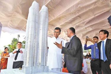Megapolis and Western Development Minister Patali Champika Ranawaka inspecting a replica of the proposed largest apartment building.