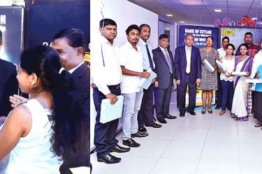 """Bank of Ceylon Chairman, Ronald C. Perera and the General Manager  D. M. Gunasekera with customers who obtained the """"Swashakthi"""" loan scheme."""