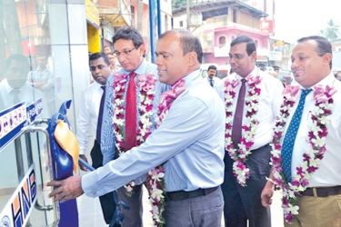 HNB Deputy General Manager - SME, Jude Fernando opening the new customer centre.  Nirosh Perera, Assistant General Manager - Network Management, V Sampanther, Senior Regional Head – Central Region Bandula Monnekulama, Regional Head – Central Region and Mithrananda Perera, Manager, HNB Akurana is in the picture.