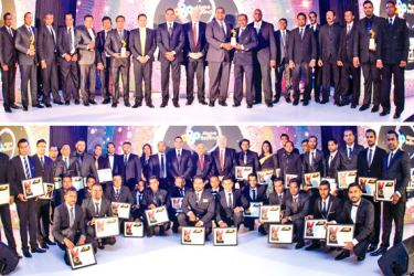 AMW officials with their awards