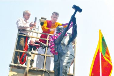 """Megapolis and Western Development Minister Patali Champika Ranawaka garlanding the statue of A.E. Gunasinha, the pioneering trade union leader known as the """"Father of the Labour Movement"""" in Sri Lanka, at Pettah yesterday. Picture by Ranjith Asanka"""