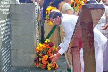 President Maithripala Sirisena placing flowers in tribute to the late President R. Premadasa at his statute in Hulftsdorp yesterday.