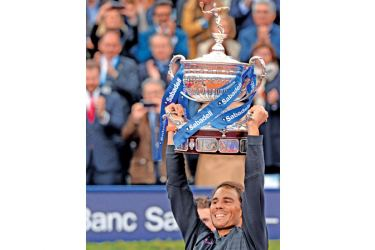 """Spanish tennis player Rafael Nadal raises his trophy as he celebrates after beating Austrian tennis player Dominic Thiem at the end of the ATP Barcelona Open """"Conde de Godo"""" tennis tournament final in Barcelona on April 30, 2017. Nadal won 6-4, 6-1."""