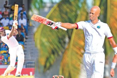 [Left:] Jason Holder of West Indies hits a boundary during the 1st day of the 2nd Test match between West Indies and Pakistan at Kensington Oval, Bridgetown, Barbados, April 30. AFP [Right: ] Roston Chase of West Indies celebrates his century during the 1st day of the 2nd Test match between West Indies and Pakistan at Kensington Oval, Bridgetown, Barbados, April 30. AFP