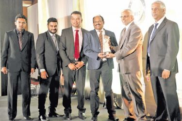 Dr. E.A. Weerasinghe (Vice Chancellor - NSBM) receiving the Overall Bronze award with NSBM and Triad Digital representatives