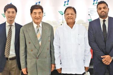 Belluna Co. Ltd, Japan Managing Director Hiroshi Yasuno, President, Kiyoshi Yasuno, Special Assignments Minister Dr. Sarath Amunugama and Asia Capital Group CEO and Director Stefan Abeyesinhe at the Marine Drive ground breaking held on Tuesday.