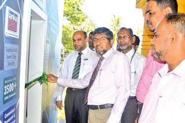 Vice Chancellor of the University Prof. M.M.M. Najim opening the offsite ATM alongside Amana Bank Vice President Operations and SME Banking M M S Quvylidh.