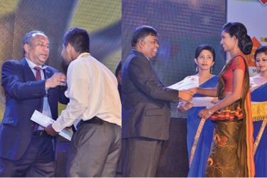 The Bank of Ceylon Chairman, Ronald C. Perera awarding a gold medal to merit award winning student and the General Manager D.M. Gunasekera  handing over certificate to a scholarship winner.