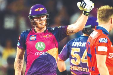 Rising Pune Supergiants cricketers Ben Stokes celebrates after scoring a century (100 runs) during the 2017 Indian Premier League (IPL) Twenty20 cricket match between Rising Pune Supergiant and Gujarat Lions at The Maharashtra Cricket Association Stadium in Pune on May 1. AFP