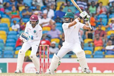 Azhar Ali (R) of Pakistan hits 4 during the 2nd day of the 2nd Test match between West Indies and Pakistan at Kensington Oval, Bridgetown,  Barbados on May 1. AFP