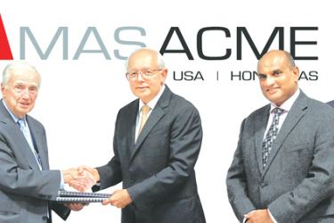 Acme McCrary Chairman Bill Redding and MAS Holdings Chairman Mahesh Amalean exchange agreements while Acme McCrary CEO Neal Anderson, MAS Holdings COO Shirendra Lawrence,Acme McCrary President Donnie White and MAS Western Hemisphere Strategy CEO Ramesh Fernando look on.