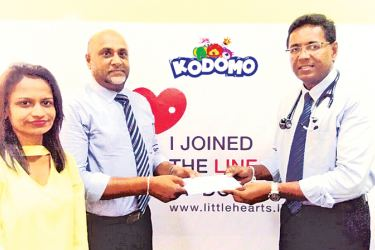 Udaya Nissanka Managing Director of UTN Trading Company (the sole agent of Kodomo SL), presenting the confirmation letter of  Kodomo sponsorship to Dr. Duminda Samarasinghe, Consultant Paediatric Cardiologist representing the Cardiology team at the Lady Ridgeway Hospital. Chanika Perera, Assistant Brand Manageress of Kodomo SL also in the picture.