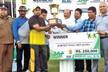 Captain of the winning team receiving the Champions Trophy from the Chief Minister of the Central Province Sarath Ekanayake. At extreme right is Sadheesh Paul, Marketing Manager of JAT Holdings Pvt Ltd.
