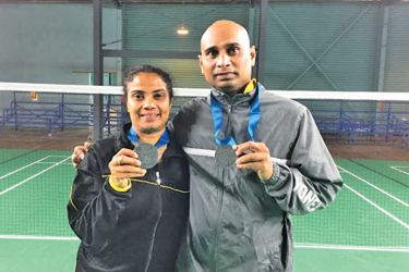 Sriyani Deepika and Upendra Jayawardena with their silver medals won during the World Masters Games in New Zealand.