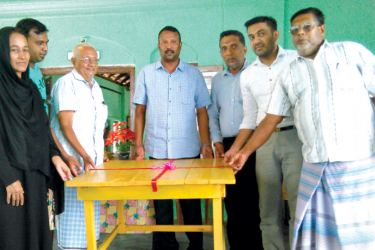 North Western Provincial Councillor N.T.M. Thahir and others with a set of new furniture provided by the Councillor for the pre-school.  Picture by M.U.M. Sanoon,  Puttalam TKN Corr.