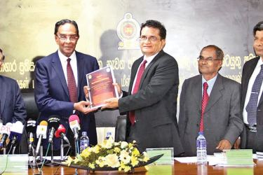 The Three Member Committee appointed to investigate into the Kalutara Prison bus attack yesterday, handed over its report to Prison Reforms, Rehabilitation, Resettlement and Hindu Religious Affairs Minister D. M. Swaminathan at the latter's ministry. Picture shows Committee Chairman Rumy Marzook handing over the report to Minister Swaminathan. Committee members S. Medawewa and Gamini Nawaratne were present.  Picture by Mahinda Vithnachchi