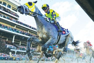 Always Dreaming #5, ridden by jockey John Velazquez, races down the front stretch during the 143rd running of the Kentucky Derby at Churchill Downs on May 6, 2017 in Louisville, Kentucky.- AFP