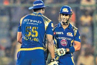 West Indians Kieron Pollard and Lendl Simmons set up Mumbai Indians 146-run demolition of Delhi Daredevils in the IPL at Delhi on Saturday.