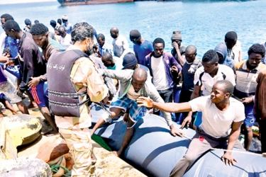 Illegal migrants, who were rescued by the Libyan coastguard in the Mediterranean Sea off the Libyan coast, arrive at the naval base in the capital Tripoli on Saturday.- AFP