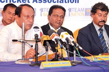 Matara District Cricket Association president Lakshman Yapa Abeywardena addressing a meeting with officials of Sri Lanka Cricket and MDCA in the presence of SLC president Thilanga Sumathipala.