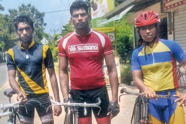 Under 40 men's cycle race winners. H Asiri Udara (left) 2nd place, Ratnasiri Medunsa (middle) first place , M Sajeewa Kumara Silva (right) 3rd place.