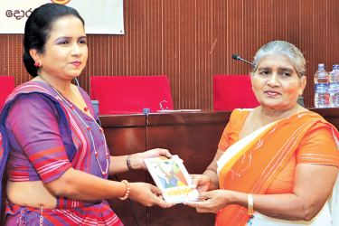 Presenting the first copy of her book to her mother  V Ranaweerarachchi. Pictures by Saman Sri Wedage