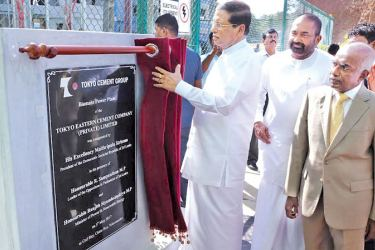 President Maithripala Sirisena inaugurates the biomass power plant while Tokyo Cement Managing Director S.R. Gnanam, Power and Renewable Energy Minister Ranjith Siyambalapitiya and officials look on.