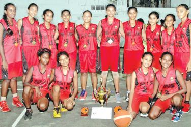 Champion St. Joseph's GS, Nugegoda U-15 basketball team with the trophy. Pictures by Sulochana Gamage