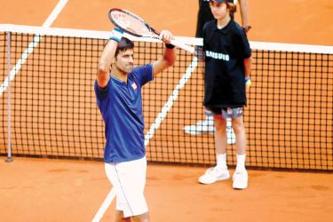 Serbian tennis player Novak Djokovic (L) celebrates his victory over Spanish tennis player Nicolas Almagro during the ATP Madrid Open in Madrid, on May 10. AFP